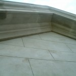 sand and cement ashlar marked render and running cornice complete