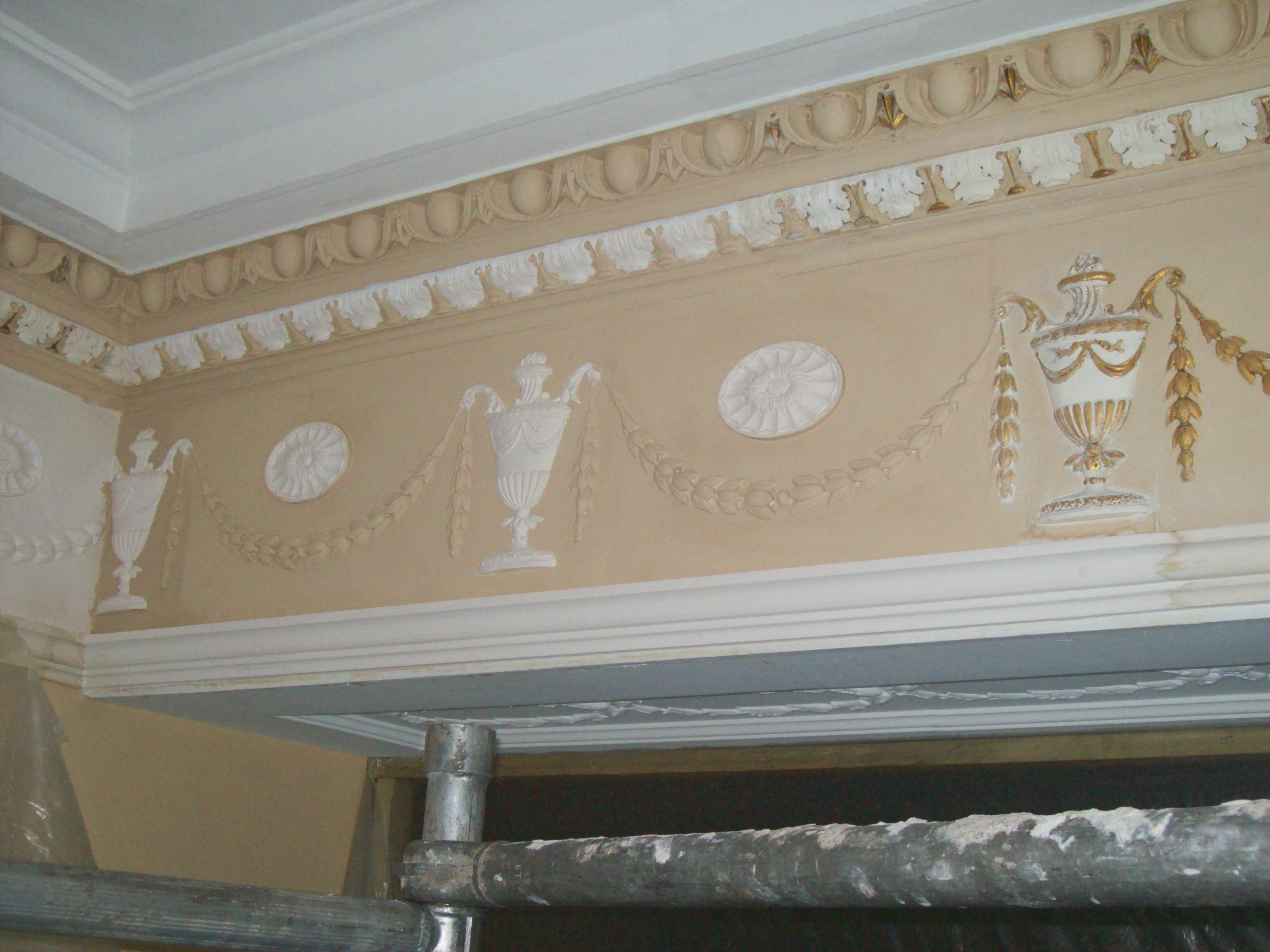 repaired ornate plaster cornice and freize, decorative plasterwork, fibrous plastering.